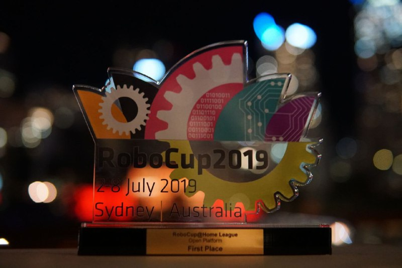 Our award with the skyline of Sydney at Harbour Side