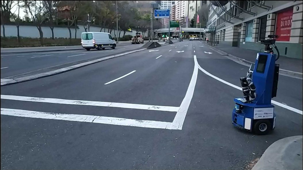 Those people in the cars must be curious about this strange machine crossing the street..