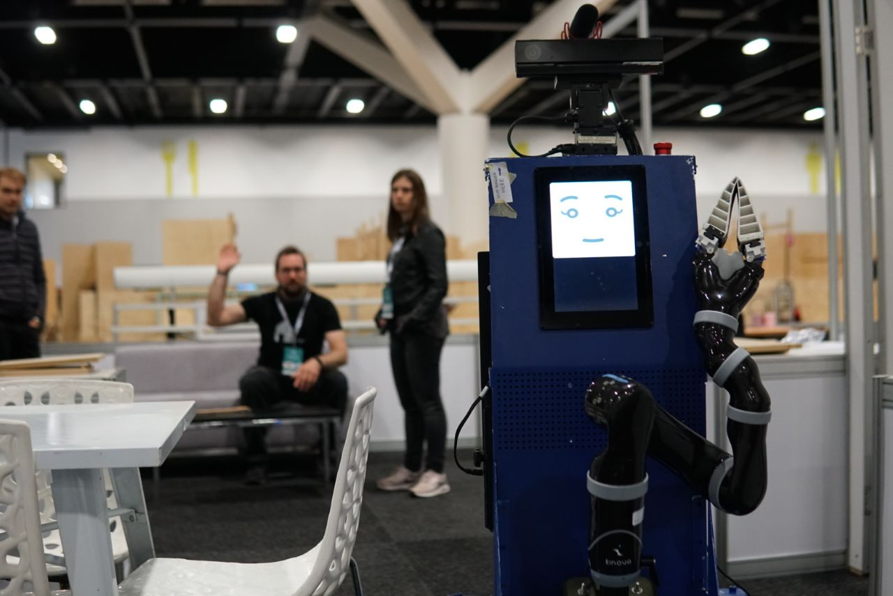 Testing receptionist with Lisa. In this task the robot has to await visitors and introduce them to the other guests. Further the robot offers the guest an empty seat