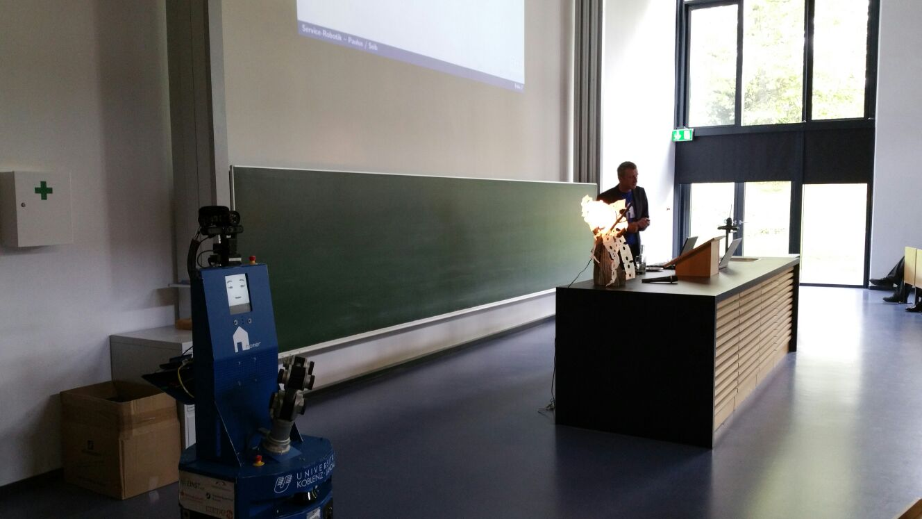Prof. Dr.-Ing. Dietrich Paulus presenting the working group, Lisa and the Spacebot cup robot at the IHK technology board