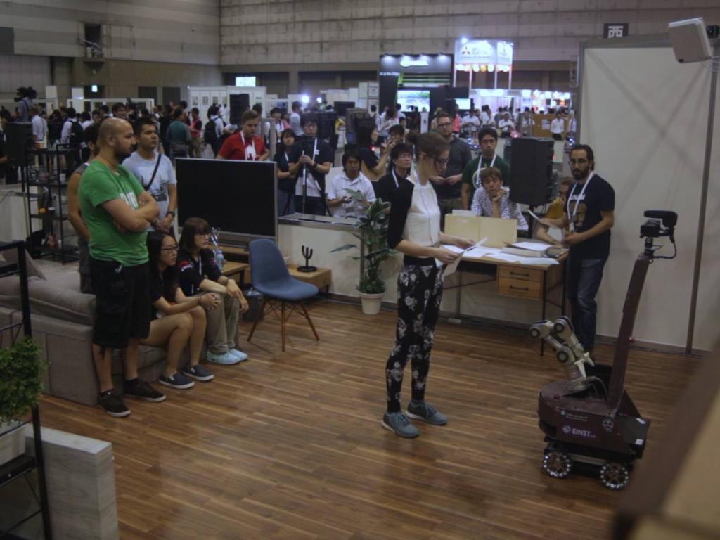 The Speech and Person recognition task. Here you see the current operator asking questions to the robot and the crowd in the background on the couch