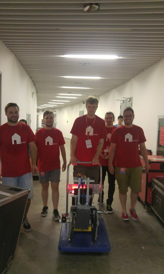 Us, on the way to the robot inspection. Before we could go on the field we had to verify that the robot fulfills the specifications made by the rulebook. That means limited size of 80x80x80 and a maximum weight of 25kg