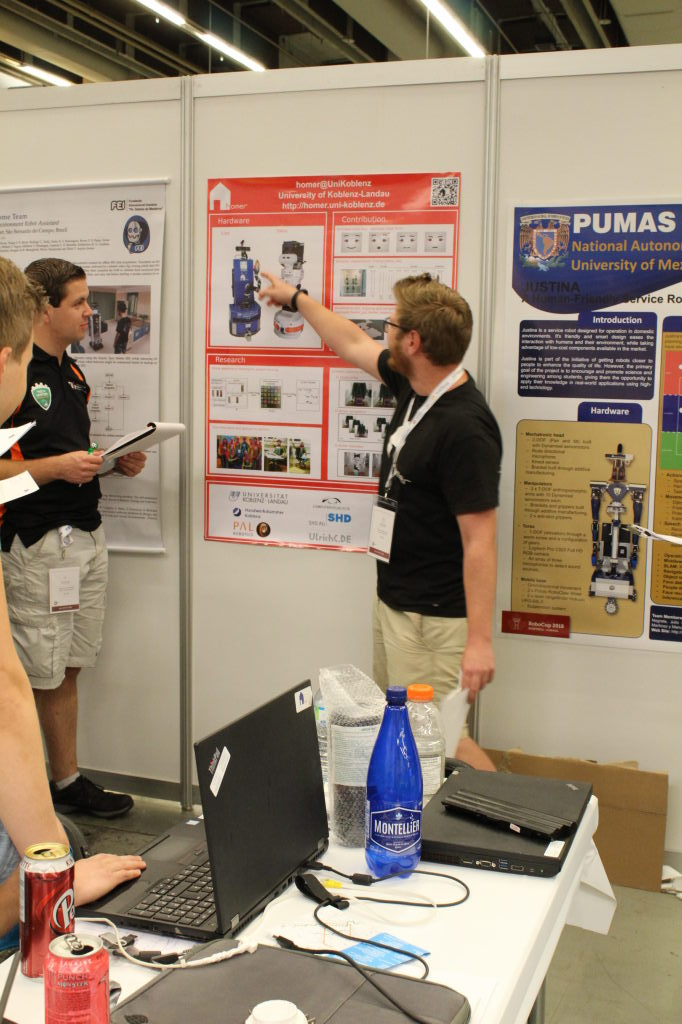 Raph at the poster session explaining a little about our robots